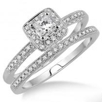 Lady's White 14 Karat Engagement Ring Set With One Princess Diamond And Round Diamonds