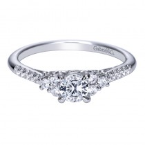 Lady's White 14 Karat Engagement Ring With One Round Diamond And Round Diamonds