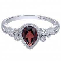 Lady's White 14 Karat Fashion Ring With One Pear Garnet And Round Diamonds